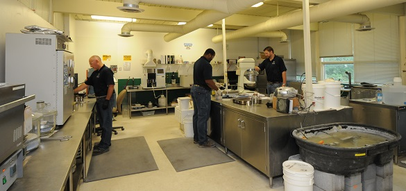 Technicians at work in our materials lab.